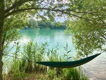Hammock time at the green lake in summerKlein Scheen, Germany royalty free stock photos