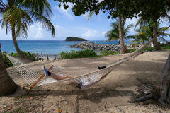 Hammock in Tranquil Tropical Setting Royalty Free Stock Photos