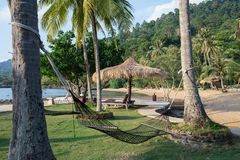 Hammock  and sunshade on a tropical beach Stock Images