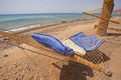 Hammock on a tropical beach Stock Photography