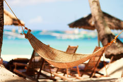 Hammock on tropical beach. Closeup photo of hammock on tropical beach Royalty Free Stock Photos