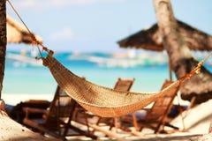 Hammock on tropical beach Royalty Free Stock Photos