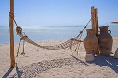 Hammock on a tropical beach Stock Photo