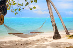 Hammock at tropical beach. Tranquil scene with tropical beach and hammock Royalty Free Stock Image