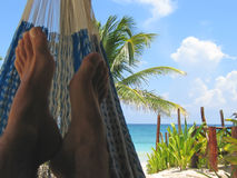 Hammock on a tropical beach. Hammock with a tropical white beach and blue sea - Tulum - Mexico Royalty Free Stock Photos