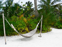 Hammock on the tropical beach. Photo of the hammock on the tropical beach of maldives island Royalty Free Stock Image