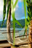 Hammock on tropical beach Royalty Free Stock Photos