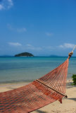 Hammock on a tropical beach. And clear sky Royalty Free Stock Photography