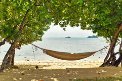 Hammock on a tropical beach. An empty hammock on a tropical beach Stock Images