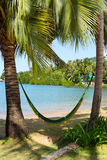 Hammock on a tropical beach Royalty Free Stock Images