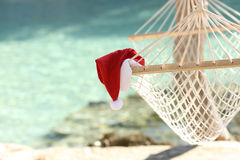Hammock on a tropical beach resort in christmas holidays. With the sea water in the background Stock Photography
