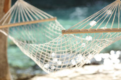 Hammock on a tropical beach resort vacation concept. Close up of a hammock on a tropical beach resort vacation concept Royalty Free Stock Images