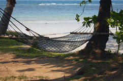 Hammock on a tropical beach resort vacation Royalty Free Stock Image