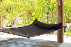 Hammock on tropical beach terrace. Travel, tourism, leisure, vacation and summer holidays concept - big hammock on tropical beach terrace Royalty Free Stock Images