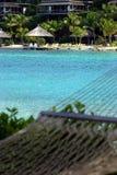 Hammock by tropical ocean Stock Photos