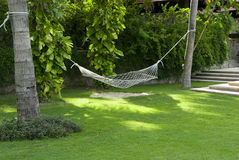 Hammock under the green shade. Green of the hammock, pure and fresh and leisure scene Royalty Free Stock Photo