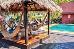 Hammock under sunshade in  tropical garden Stock Photos