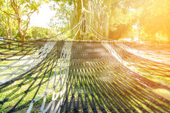 Hammock under the tree in garden for relaxation. Close-up hammock under the tree in garden for relaxation Royalty Free Stock Images