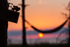 Hammock under the trees with beautiful sunrise in background.  Stock Image
