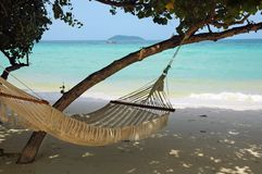 Hammock with a view. An hammock on a paradisiacal beach Stock Photo