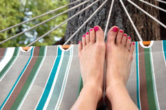 Hammock and Womans Feet Royalty Free Stock Photography