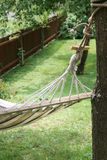Hammock in yard Royalty Free Stock Photos