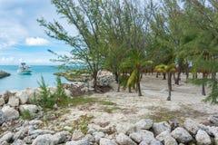 Hammocks, beach, ocean, and a boat Royalty Free Stock Photo