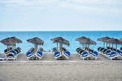 Hammocks and beach umbrellas in Marbella Stock Image