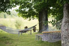 Hammocks on countryside Royalty Free Stock Photos
