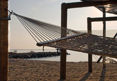 Hammocks do recurso no por do sol Imagem de Stock Royalty Free