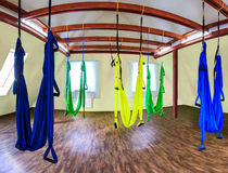 Hammocks for fly yoga. Hanging hammocks in gym for aerial (fly) yoga Stock Image