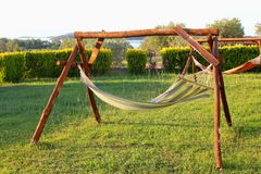 Hammocks in the garden relaxing. Hammocks in the garden for relaxing leisure time at home Royalty Free Stock Image