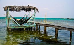 Hammocks no oceano Foto de Stock Royalty Free
