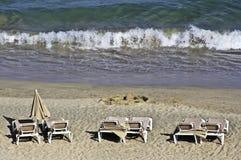 Hammocks and parasols on the beach Royalty Free Stock Image