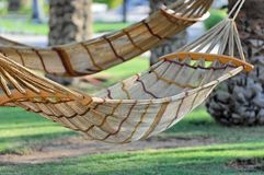 Hammocks tied to trees Stock Photos