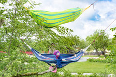 Hammocks between trees. Two colorful hammocks hanging between trees Stock Photography