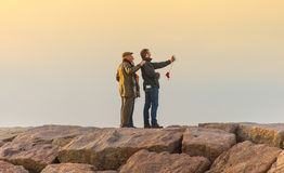 Selfie - Hammonasset. Madison, CT, USA - Nov 19, 2011: Parents pose with their adult son for a selfie at sunset on the jetty at Hammonasset Beach State Park Stock Photos