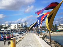 Hamn med flaggor i Agia Napa Arkivbild