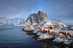 Hamnoy fishing village on Lofoten Islands, Norway. Famous tourist attraction Hamnoy fishing village on Lofoten Islands, Norway with red rorbu houses in winter Royalty Free Stock Photography