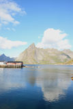 Hamnoy's mount mirroring in the harbour royalty free stock image
