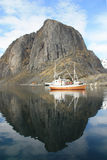 Hamnoy's mounts and boat  mirroring Royalty Free Stock Image