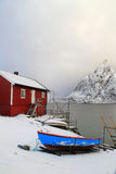 Hamnoy's rorbuer and boat Stock Photos