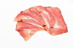Hamon sliced on white background. Spanisch traditional meat royalty free stock images