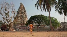 HAMPI, INDIA - APRIL 2013: Local boys at Hindu temple Stock Image
