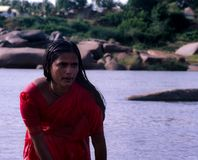 Hampi, India: Woman washing in the river stock image