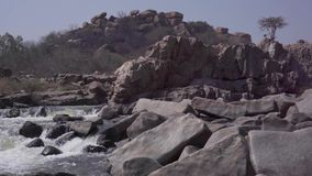 Stormy river in India. Hampi Karnataka India march 28 2019: Tungabhadra River stock video footage