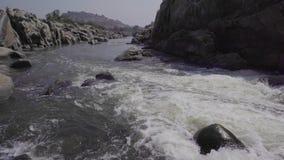 Stormy river in India. Hampi Karnataka India march 28 2019: Tungabhadra River stock footage