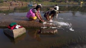 Hampi river people stock video