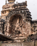 Hampi ruins. Statue of lord ganesha on a hindu temple in hampi. Bunch of monkey taking shelter form the rains royalty free stock image