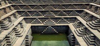Hampi ruins. Stepped religious pool recently excavated in Hampi stock image